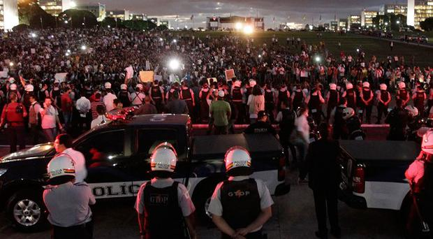 Demonstrators gather during a protest in front of the Brazilian National Congress in Brasilia (AP)