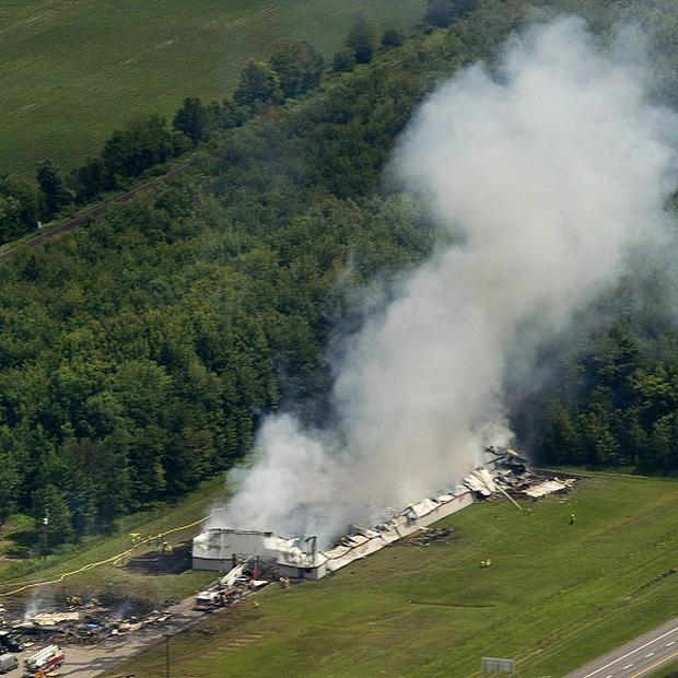 Smoke billows from the BEM fireworks factory in Coteau du Lac, Quebec, following an explosion (AP/The Canadian Press, Graham Hughes)