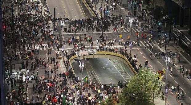 People gather along Paulista Avenue to celebrate the reversal of a fare hike on public transportation in Sao Paulo, Brazil (AP/Nelson Antoine)