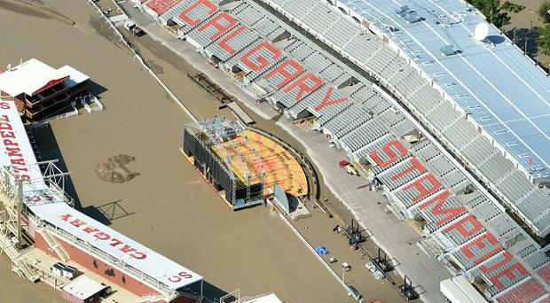 The Calgary Stampede grounds immersed in water during heavy flooding in Calgary (AP/The Canadian Press, Jonathan Hayward)