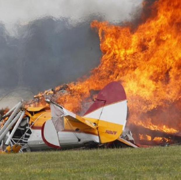 Flames erupt from a plane after it crashed at the Vectren Air Show at the airport in Dayton, Ohio (AP/Dayton Daily News, Ty Greenlees)