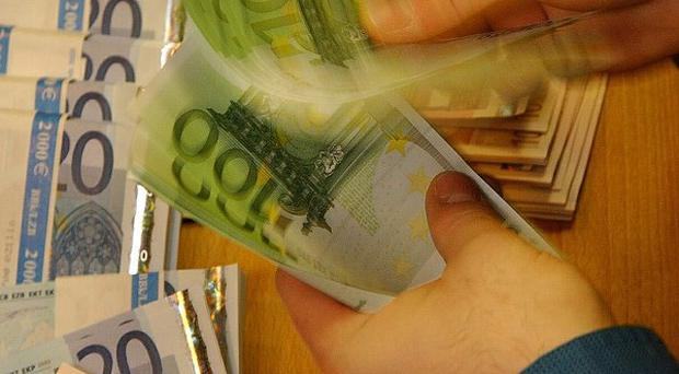 €20 million of fake notes have been seized in the Republic of Ireland. Picture posed