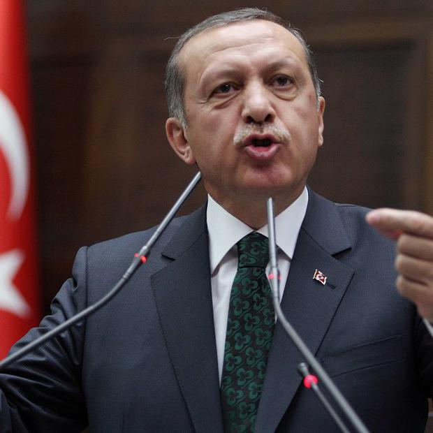 Turkish Prime Minister Recep Tayyip Erdogan addresses politicians at the parliament in Ankara (AP)