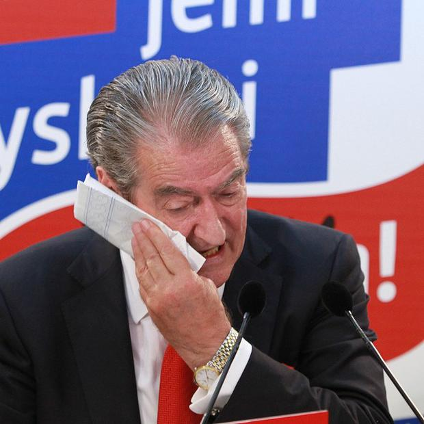 Albanian prime minister Sali Berisha concedes defeat in front of his supporters at the party headquarters in Tirana (AP)