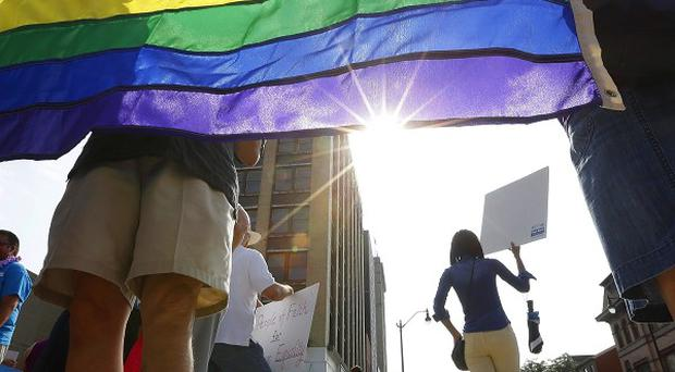 Supporters for same-sex marriage rally in Springfield, Illinois (AP)