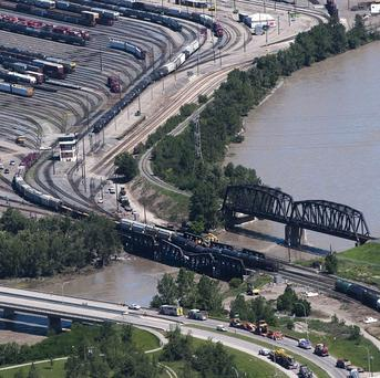 Crews at the scene of a rail bridge collapse south-east of Calgary (AP/The Canadian Press)