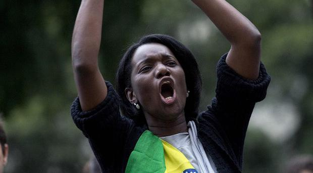 A woman shouts during an anti-government protest in Rio de Janeiro, Brazil (AP)