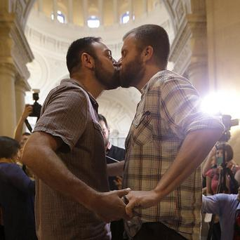 Craig Stein kisses Bobby Meadows as they are married at City Hall in San Francisco (AP)
