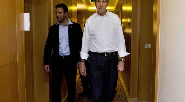 US Secretary of State John Kerry returns to his room at the end of a long night (AP)