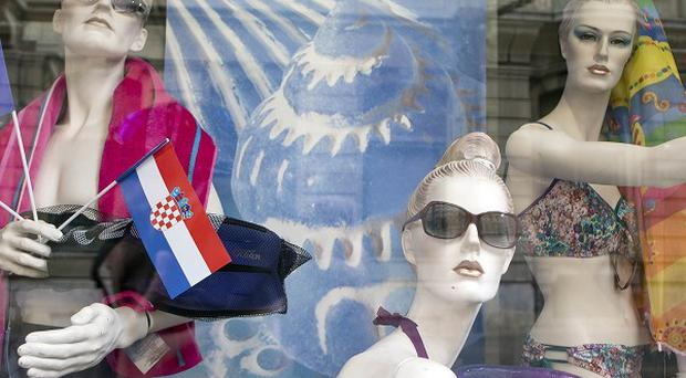 Window mannequins with EU and Croatian flags are on display in a shop window in downtown in Zagreb (AP)