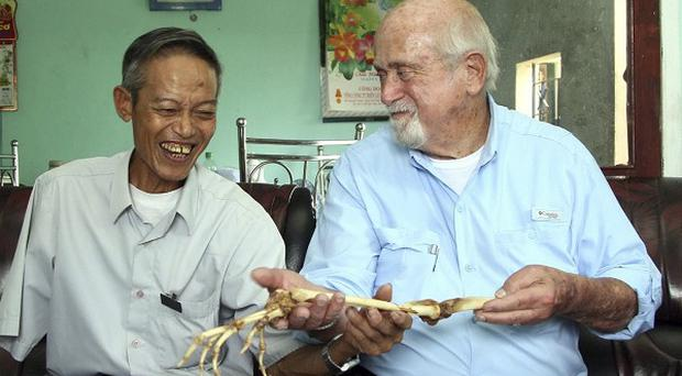Dr Axelrad, former North Vietnamese soldier Nguyen Quang Hung and the arm bones (AP)