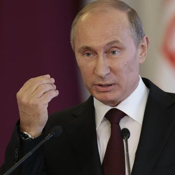 Russian leader Vladimir Putin has said Edward snowden will have to stop leaking US secrets if he is to gain asylum (AP