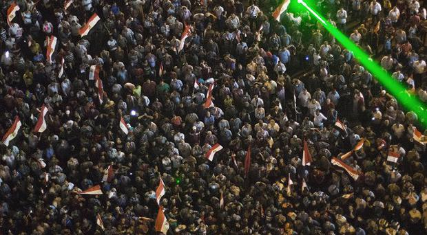 Thousands of Egyptian protesters gather in Cairo's Tahrir Square to rally against president Mohammed Morsi (AP)