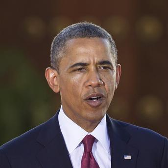 Barack Obama was accused of practising the 'old, bad tools of political aggression' (AP/Ben Curtis)
