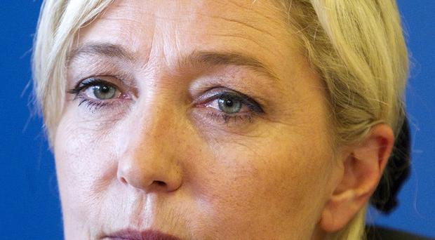 French far-right leader Marine Le Pen intends to defend herself against racism charges (AP)