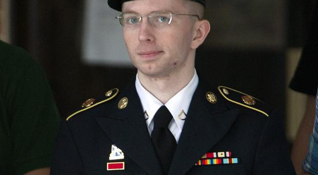 Army Pfc Bradley Manning is escorted out of a courthouse in Fort Meade (AP/Jose Luis Magana)