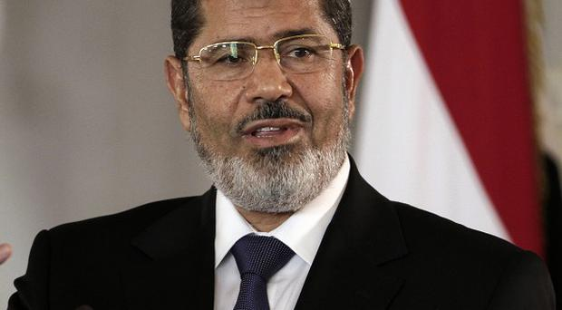 Egyptian President Mohammed Morsi vowed to protect his 'constitutional legitimacy' with his life (AP/Maya Alleruzzo)