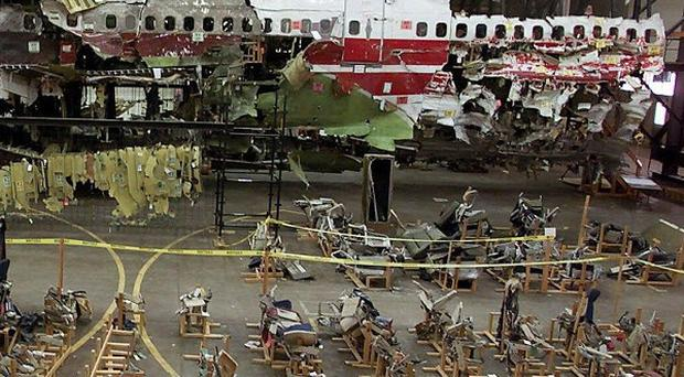 The reconstructed wreckage of TWA Flight 800 in a hangar (AP/ Ed Betz)