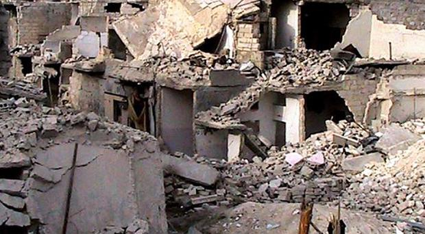 Homes destroyed by Syrian government airstrikes and shelling near Aleppo International Airport (AP)