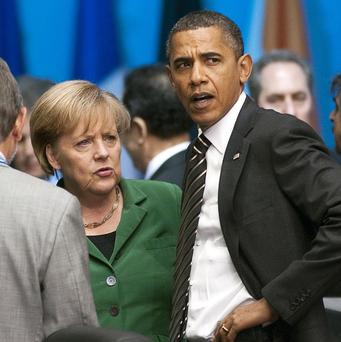 Barack Obama and Angela Merkel are to discuss reports of surveillance activities by the US National Security Agency