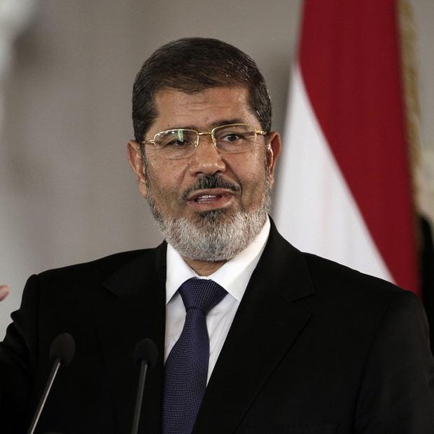 Egyptian President Mohammed Morsi has been ousted, the country's military has announced (AP)