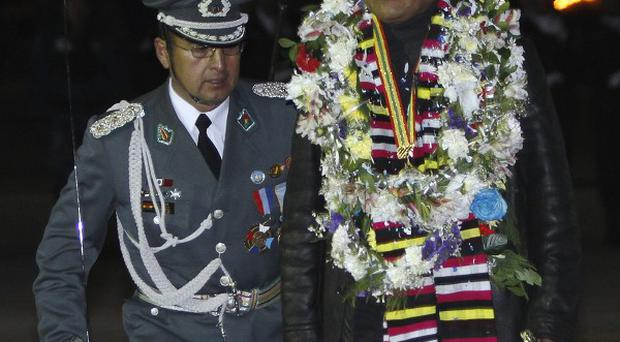 Bolivia president Evo Morales is greeted upon his arrival home at the airport in El Alto after an unplanned 14-hour stopover in Vienna (AP)