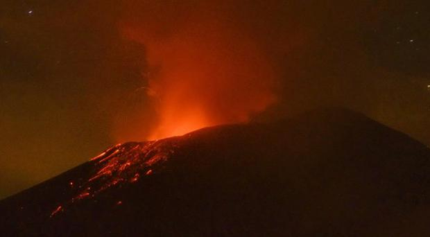 Lava flows from the Popocatepetl volcano after an eruption (AP/Arturo Andrade)