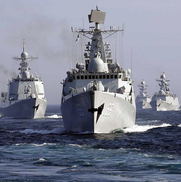 China is thought to be working to fit the ray gun on ships. Above: Chinese destroyer Wuhan leads a fleet of naval ships taking part in a joint exercise with Russia in the Sea of Japan (AP)