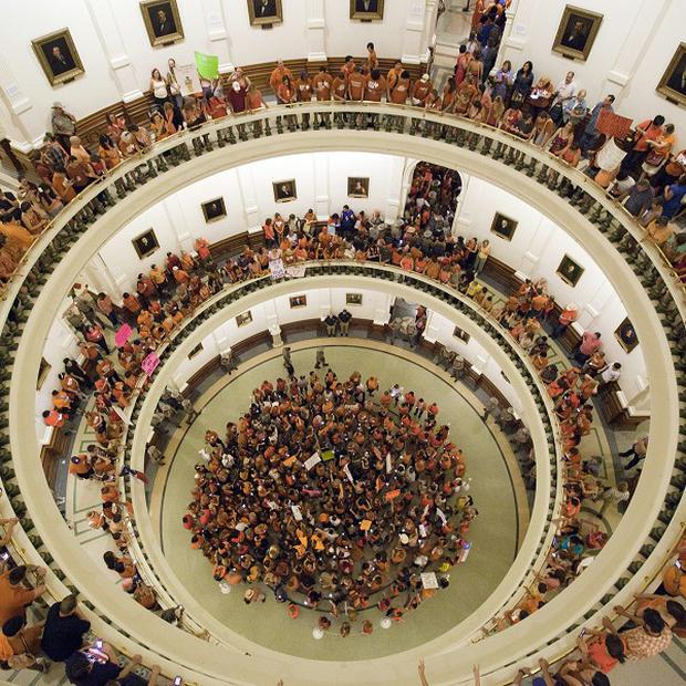 Abortion rights advocates fill the rotunda of the Texas State Capitol ahead of the vote on abortion restrictions (AP)