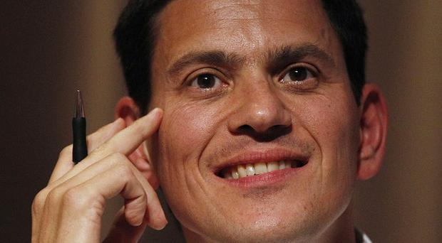 David Miliband said the 'overall reckoning' in Iraq is 'strongly negative', and also suggested Afghanistan could suffer many more years of civil conflict