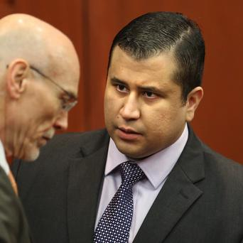 George Zimmerman, right, has been cleared of the murder of Trayvon Martin (AP)