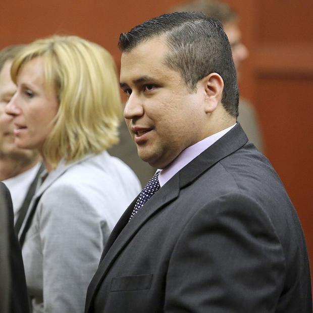 George Zimmerman, right, is pictured after being cleared of the murder of Trayvon Martin (AP)
