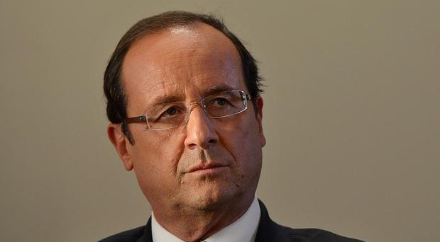 The office of President Francois Hollande has formally confirmed the death of a French hostage in Mali