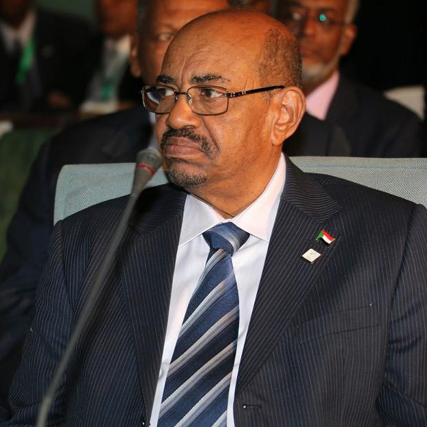 Sudanese president Omar al-Bashir was attending an African Union summit in Nigeria when calls for his arrest were made (AP)