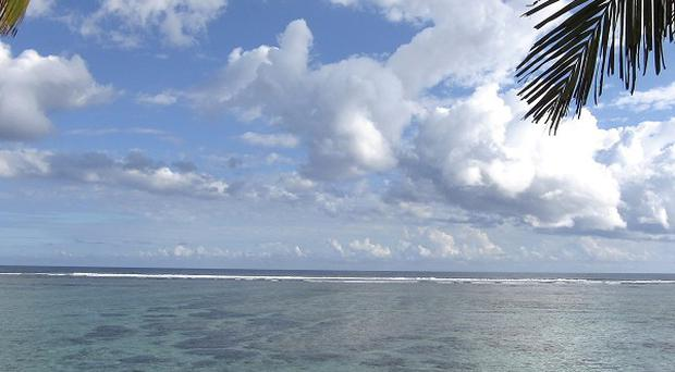 The beach of Saint-Paul, on Reunion island, where a teenage girl was killed by a shark while snorkelling (AP)