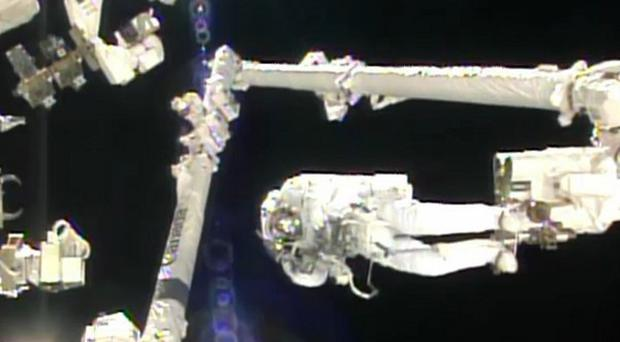 Italian astronaut Luca Parmitano stands on the end of a robotic arm during a spacewalk outside the International Space Station (AP/Nasa)