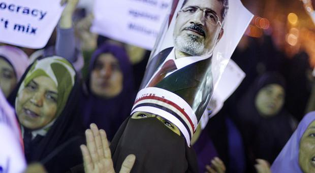 Supporters of Egypt's ousted president Mohammed Morsi protest in Cairo (AP)