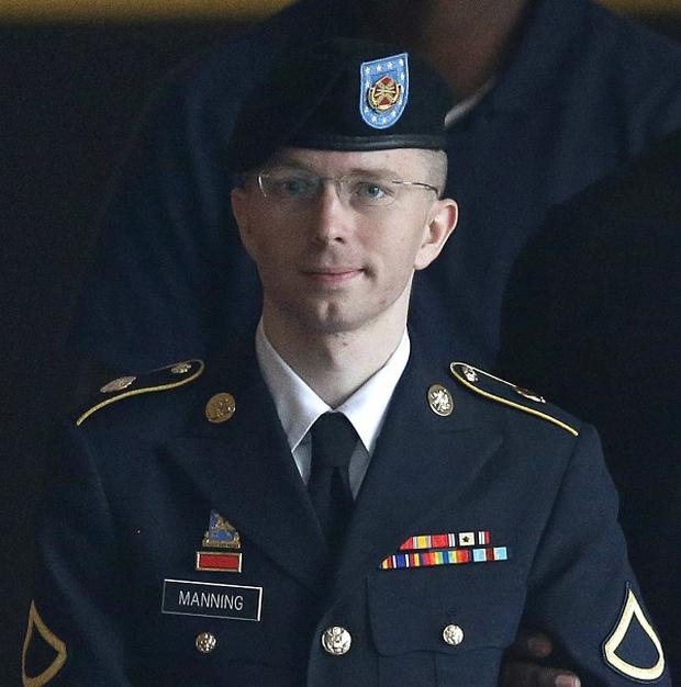 Bradley Manning's defence team urged a judge to dismiss a charge he aided the enemy (AP)