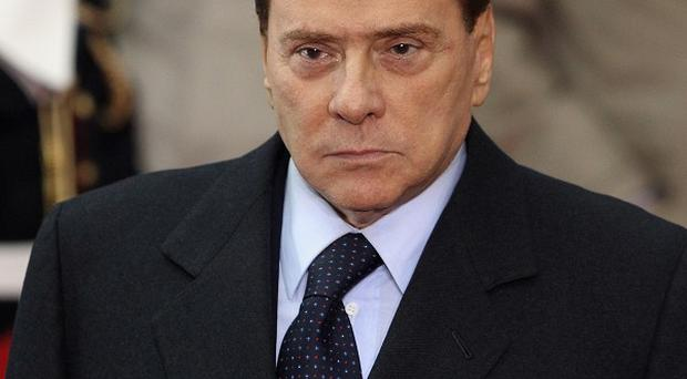 Three former aides of Silvio Berlusconi have been convicted of procuring prostitutes for his 'bunga bunga' parties