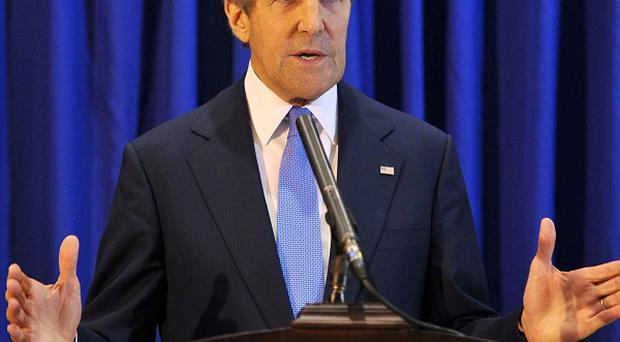 John Kerry said he expects Israeli and Palestinian negotiators to hold initial talks 'within the next week or so' (AP)