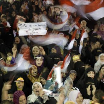 Supporters of Egypt's ousted President Mohammed Morsi during a protest in a park in front of Cairo University (AP/Amr Nabil)