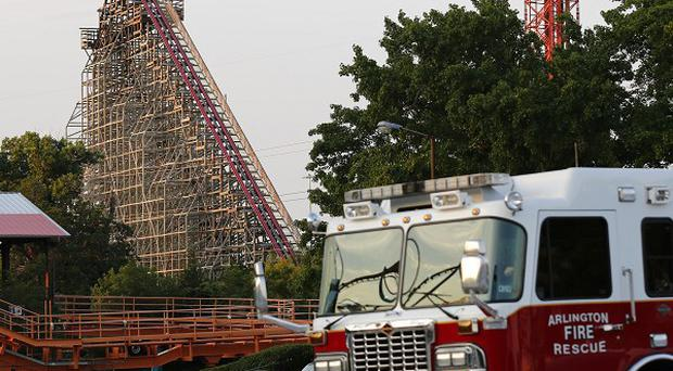 A woman riding a rollercoaster has died after falling from the attraction at Six Flags Over Texas in Arlington (AP/The Dallas Morning News, Tom Fox)