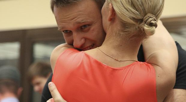 Russian opposition leader Alexei Navalny embraces his wife, Yulia, as he was released in a courtroom in Kirov (AP)