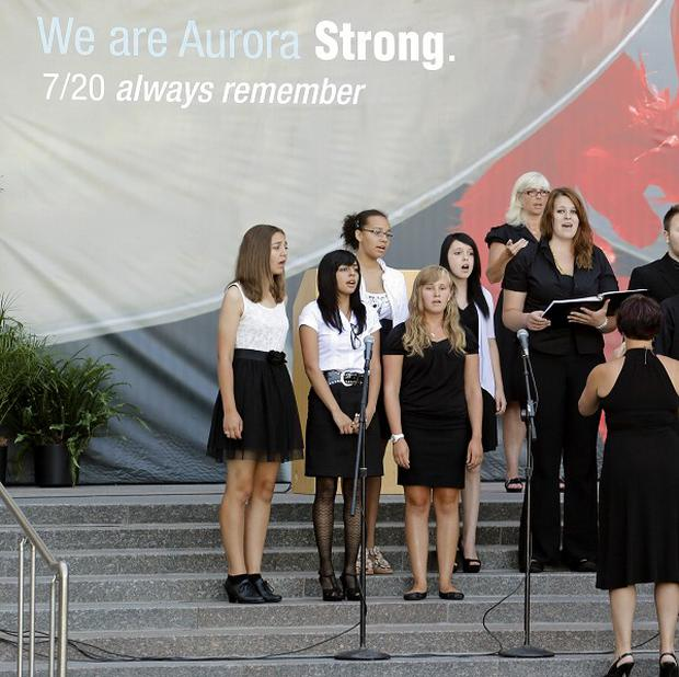 Members of the Hinkley High School Choir sing Amazing Grace at a memorial service for the victims of the Aurora cinema shooting in Colorado (AP)