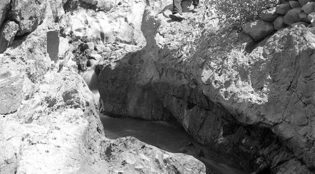 In this 1905 photo a channel in bedrock worn by tailings of the Cherokee hydraulic mine in Butte County, California (AP/US Geological Survey)