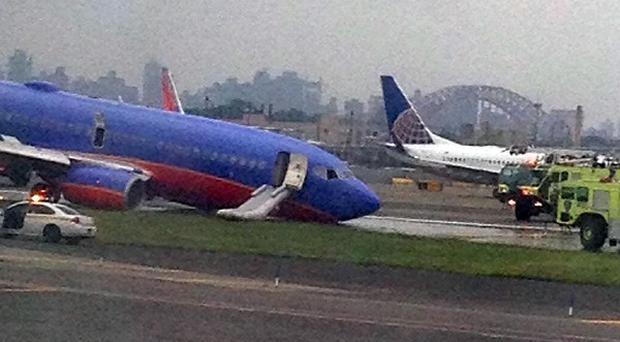 A Southwest Airlines plane with collapsed nosegear at LaGuardia Airport in New York (AP/Jared Rosenstein)