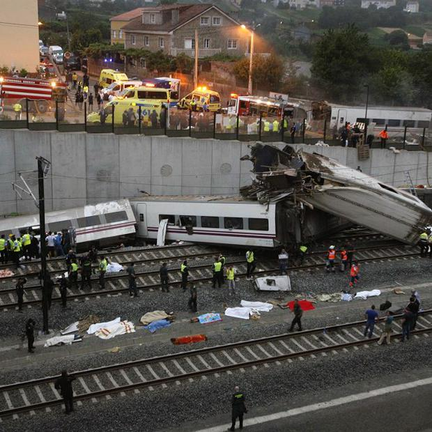 Emergency personnel respond to the scene of a train derailment in Santiago de Compostela, Spain (AP)