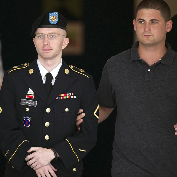 Bradley Manning, in uniform, is escorted from the courthouse at Fort Mead, Maryland (AP)