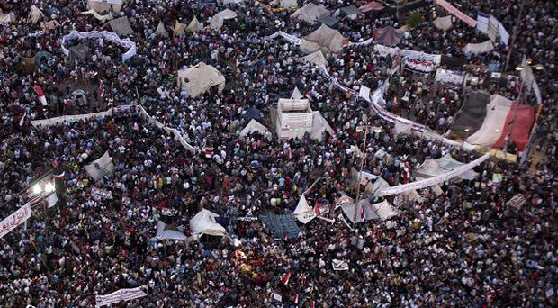 Supporters of Egypt's top military officer, Abdel-Fatah el-Sissi, rally in Tahrir Square in Cairo, Egypt (AP)