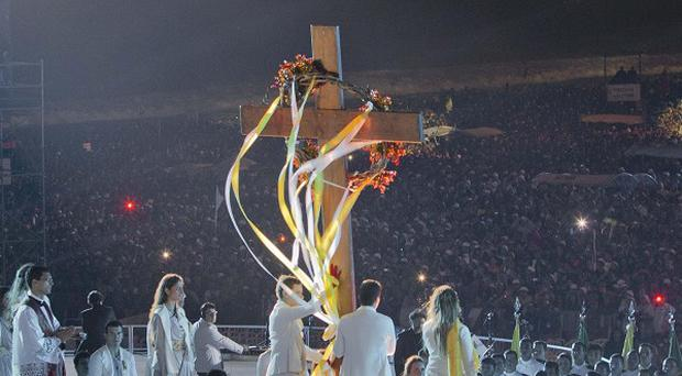 The World Youth Day Cross is placed on the last station during the event on the Copacabana beachfront in Rio de Janeiro, Brazil (AP)